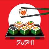 Con i rotoli di sushi ed i bastoncini su un piatto Fotografia Stock Libera da Diritti