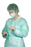 Con la máscara quirúrgica Fotos de archivo libres de regalías