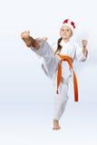 Con la muchacha anaranjada de la correa en el casquillo de las huelgas de Santa Claus un soplo Fotografía de archivo libre de regalías