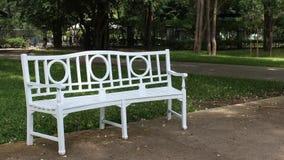 Con la sedia in parco Fotografia Stock