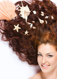 Con los shelles en pelo largo Fotos de archivo libres de regalías
