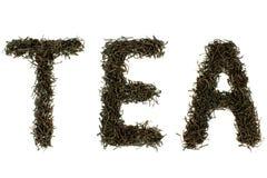 Con nero \ TÈ \ testo delle foglie di tè Fotografia Stock