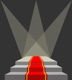 Con una alfombra roja Podio y reflectores Iluminación del pede Imagenes de archivo