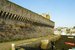 Concarneau fortification. At sunrise in front of the port in brittany in france Stock Images