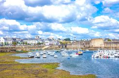 Landscapes and architectures of Brittany. Concarneau, France - August 10, 2017: View of the De La Plaisance harbor with the ramparts of Ville Close in the Royalty Free Stock Images