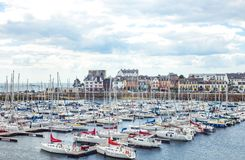 Landscapes and architectures of Brittany. Concarneau, France - August 10, 2017: View of the De La Plaisance harbor with the ramparts of Ville Close in the Royalty Free Stock Photos