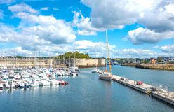 Landscapes and architectures of Brittany. Concarneau, France - August 10, 2017: View of the De La Plaisance harbor with the ramparts of Ville Close in the Stock Photography