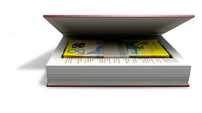 Concealed Australian Dollar Bank Notes In A Book Front. A red hardback book with a cutaway area in the pages concealing a stack of fifty australian dollar bank Royalty Free Stock Images