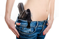 Concealed carry gun in his waistband Royalty Free Stock Photography