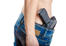 Concealed carry gun in his waistband Royalty Free Stock Images