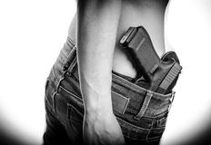 Concealed carry gun in his waistband Stock Photography