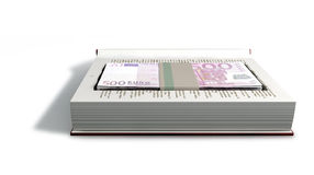Concealed Euros In A Book Front. A red hardback book with a cutaway area in the pages concealing a stack of five hundred euro notes on an isolated background Stock Photography