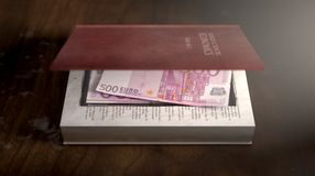 Concealed Notes In A Book. A red hardback book with a cutaway area in the pages concealing a stack of euro notes on an isolated background Royalty Free Stock Photos