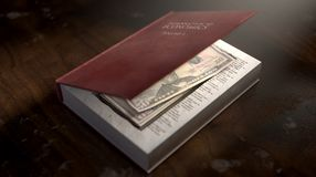 Concealed Notes In A Book. A red hardback book with a cutaway area in the pages concealing a stack of US dollar notes on an isolated background Stock Image