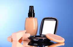 Concealer, face powder and sponges Stock Images