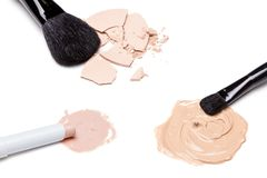 Concealer, foundation and powder with brushes Royalty Free Stock Photos