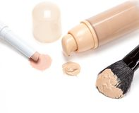 Concealer pencil and foundation with makeup brush Royalty Free Stock Photography