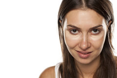 Concealer under the eyes Royalty Free Stock Photo