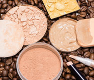 Concealers, foundation, powder on coffee beans Royalty Free Stock Photo