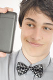 Conceited businessman taking a selfie photo with his smart phone Royalty Free Stock Images