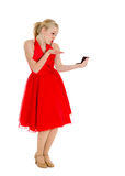 Conceited Girl in Red with Mirror. Old Fashioned Conceited Teen Girl Kissing Mirror royalty free stock photo