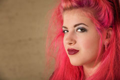 Conceited Punk Teen. Conceited teenage female with pink hair close up royalty free stock image