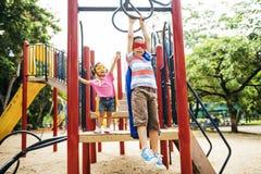 Conceito brincalhão de Elementary Childhood Kid da irmã do irmão Fotos de Stock