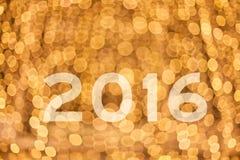 conceito 2016 com bokeh dourado real Imagens de Stock Royalty Free
