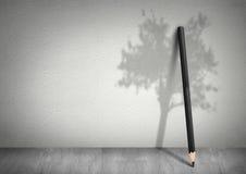 Conceito criativo da ecologia, lápis com sombra da árvore Fotografia de Stock