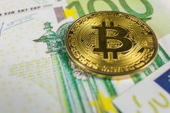 Conceito cripto da moeda - um bitcoin com euro- contas imagem de stock