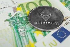 Conceito cripto da moeda - um Ethereum com euro- contas fotografia de stock