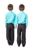 Conceito da amizade - opinião traseira dois rapazes pequenos isolados no wh Fotografia de Stock Royalty Free