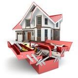 Conceito da construção e do reparo Caixa de ferramentas com ferramentas e casa, Imagens de Stock Royalty Free