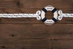 Conceito da cooperação: Fundo náutico marrom de madeira com um azul Fotografia de Stock Royalty Free