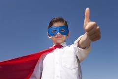 Conceito da criança do super-herói Fotografia de Stock Royalty Free