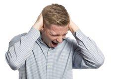 Homem de negócios desesperado que shouting com mãos na cabeça. Imagem de Stock Royalty Free