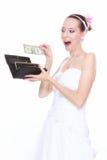 Conceito da despesa do casamento. Noiva com bolsa e um dólar Imagens de Stock Royalty Free