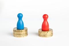 Conceito da diferença de salário fotografia de stock