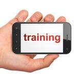 Conceito da educação: Formação no smartphone Foto de Stock Royalty Free