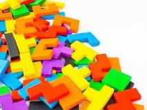 Conceito da educação o de madeira colorido do enigma do tangram fotografia de stock