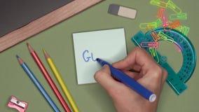 Conceito da escola OBJETIVO da escrita da mão da mulher no bloco de notas filme