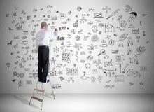 Conceito da faculdade criadora tirado por um homem em uma escada Imagens de Stock Royalty Free