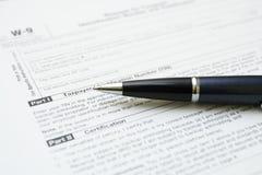 Conceito da finança com formulário de imposto W9 Foto de Stock