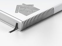 Conceito da finança: livro fechado, casa no fundo branco Imagem de Stock Royalty Free