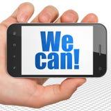 Conceito da finança: Mão que guarda Smartphone connosco podemos! na exposição Foto de Stock Royalty Free