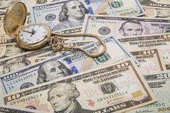 Conceito da gestão de dinheiro do tempo fotografia de stock