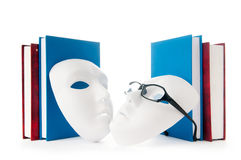 Conceito da leitura com máscaras, livros Fotografia de Stock Royalty Free