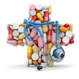 Conceito da medicina. Cruz dos comprimidos e do estetoscópio. Fotos de Stock Royalty Free