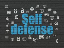 Conceito da proteção: Autodefesa no fundo da parede Fotos de Stock