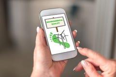 Conceito da qualidade ambiental em um smartphone fotografia de stock royalty free